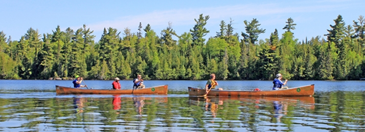 voyageur canoe paddling in the Boundary Water Canoe Area Wilderness