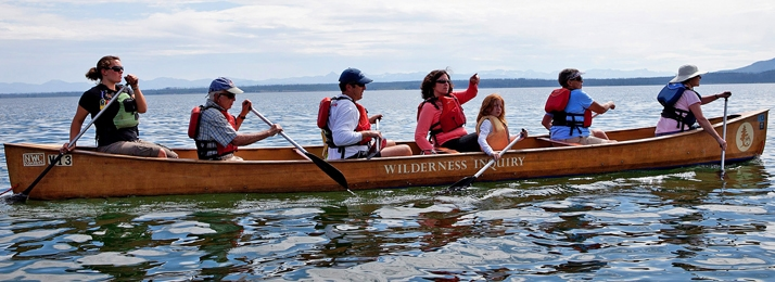 Family Outdoor Vacations include activities like paddling voyageur canoes in Yellowstone National Park