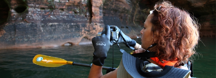 women taking photo while kayaking in the Apostle Islands