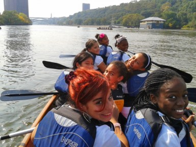 Students paddle on the Harlem River in the Bronx, NY