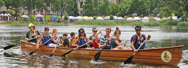 paddling a Voyageur canoe at Pride Festival