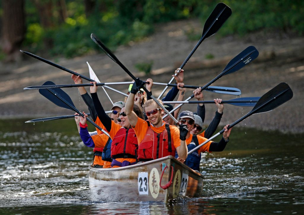 Contestants in Wilderness Inquiry's Great River Race celebrate