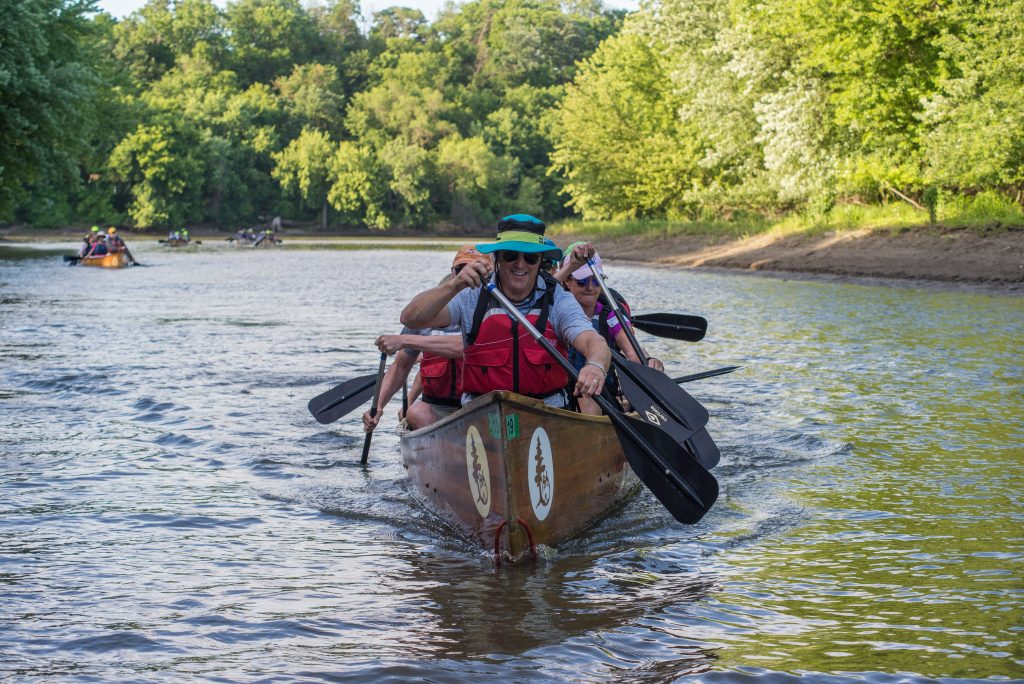 Participants paddle during Wilderness Inquiry's Big Wine and Cheese Affair