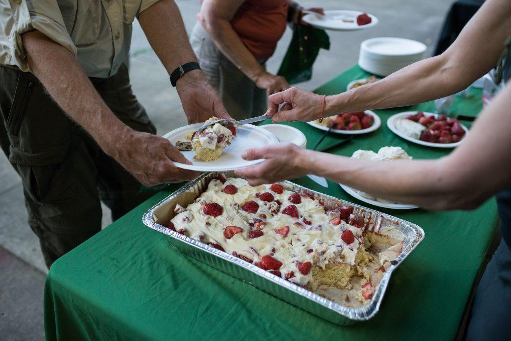Chef Beth Dooley serves guests dessert.
