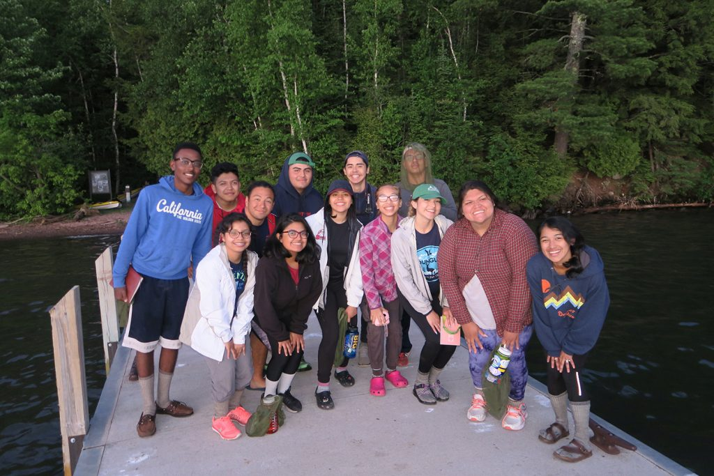 Students from The Woods Project line up on a dock for their picture