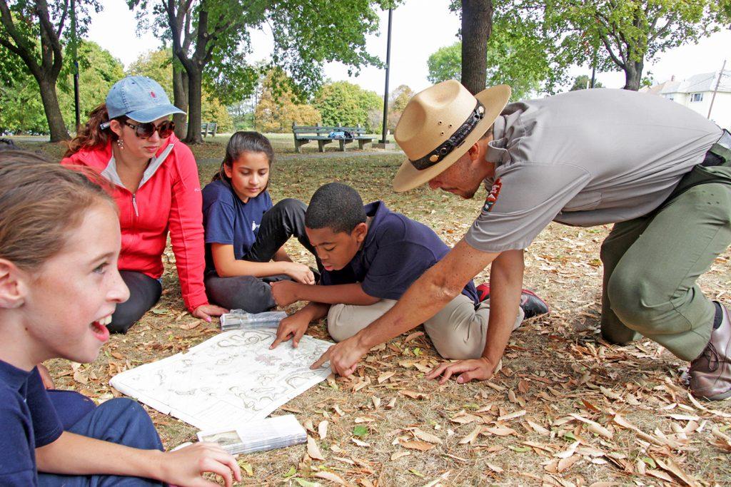 A National Park Ranger teaches students