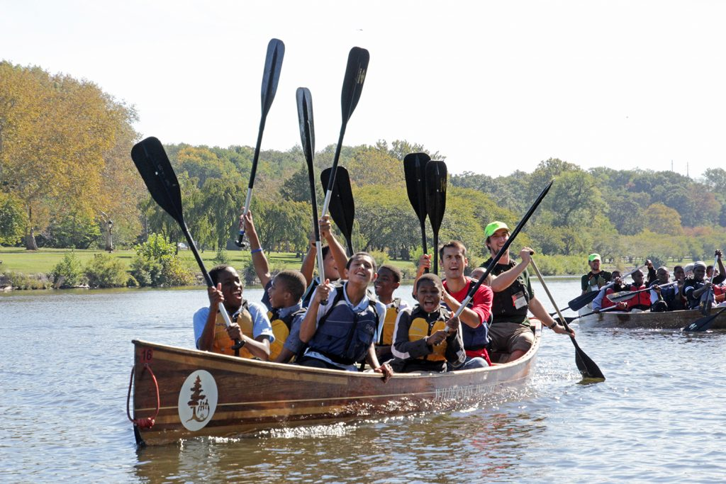 Students celebrate learning during a Canoemobile expedition