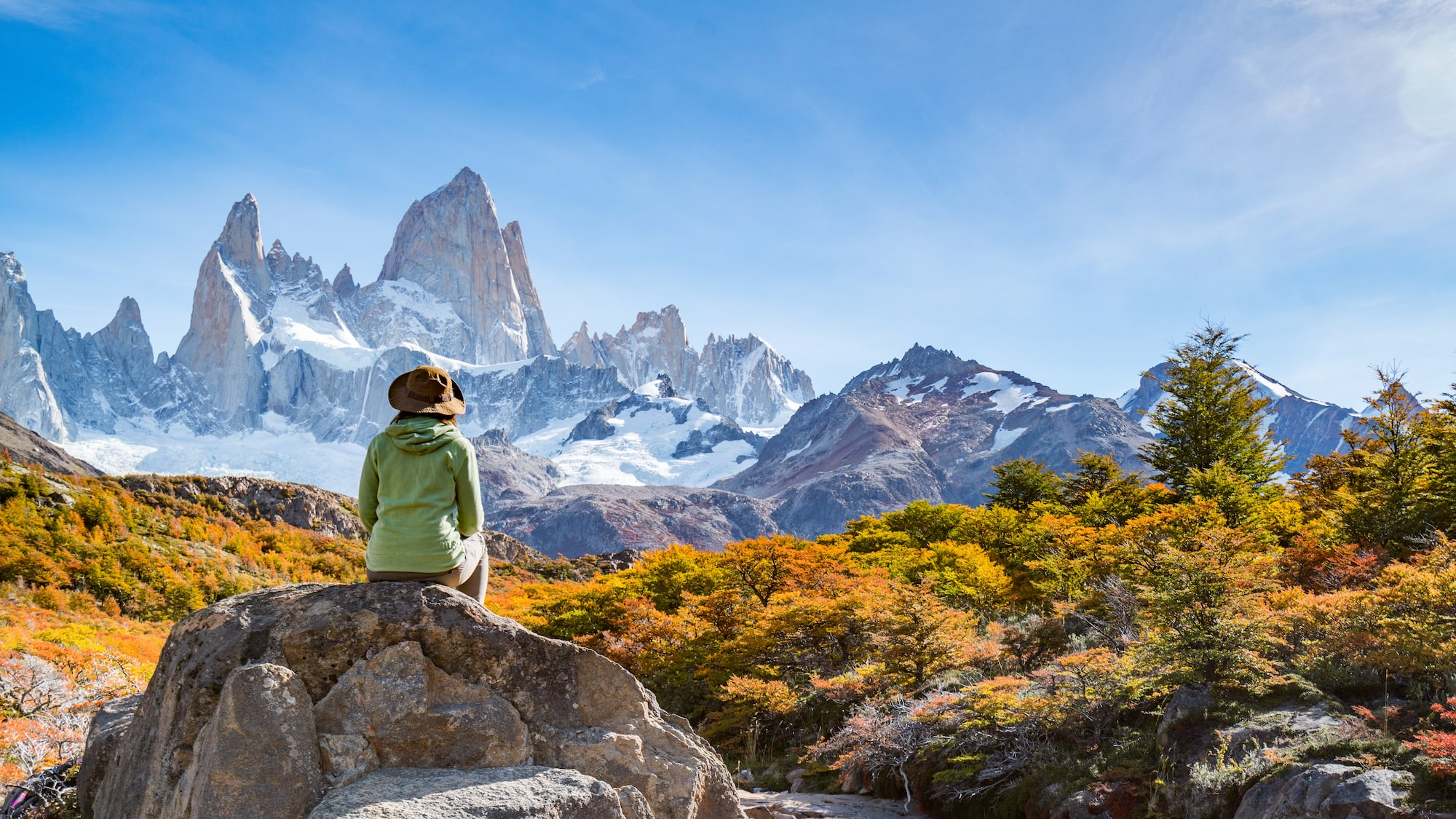 Woman sitting on rock in Patagonia