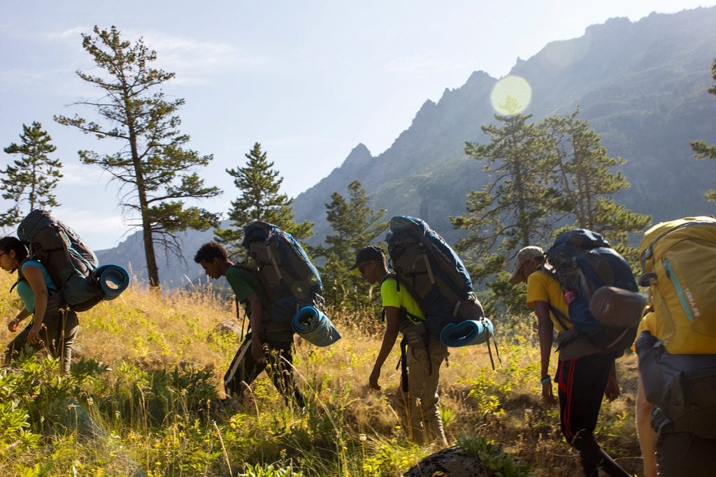 Edison High School students hiking uphill in the Beartooth Mountains