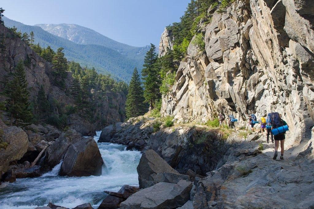 Hiking a narrow path along the river