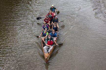 The Gradys paddle under the bridge