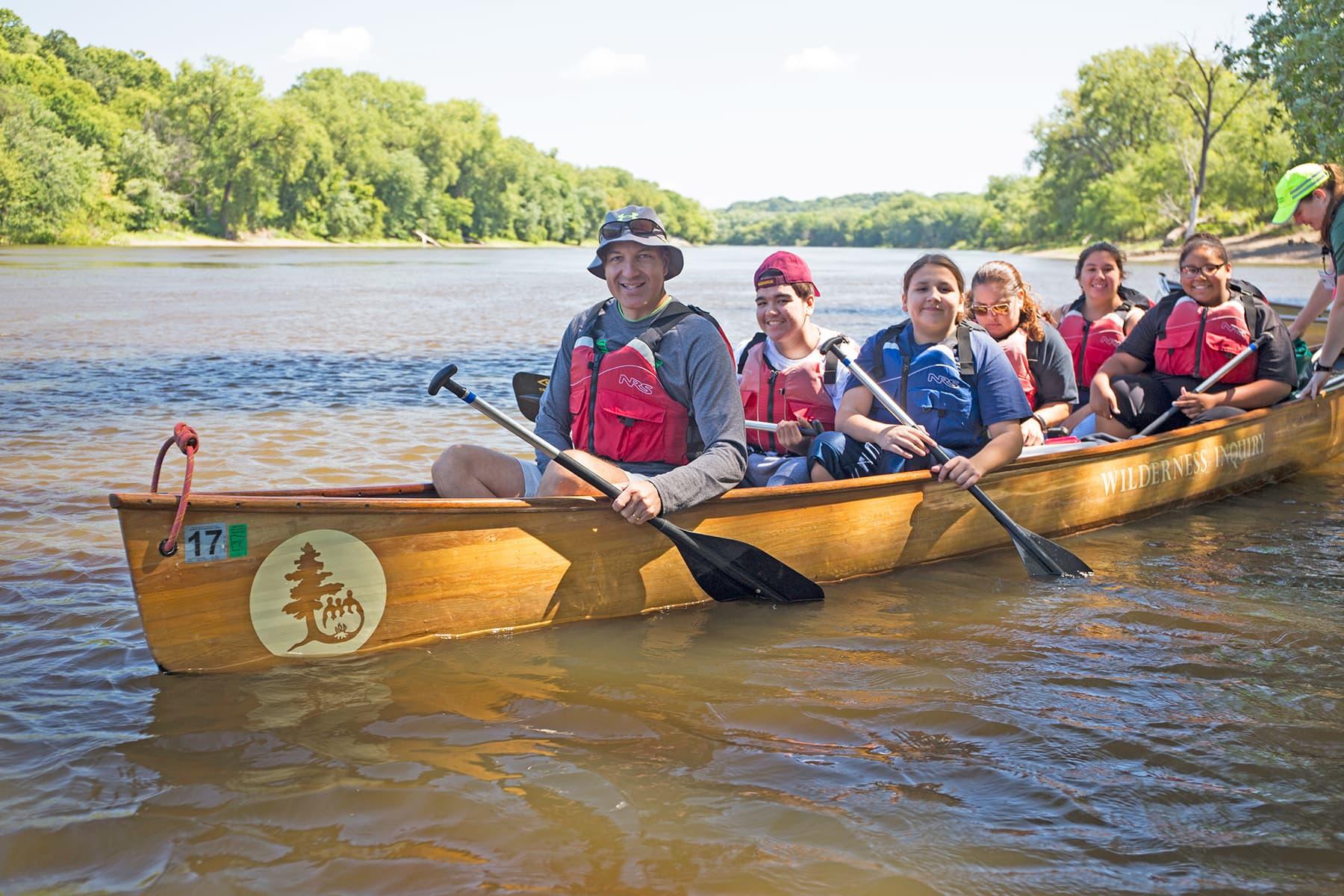 Superintendent Joe Gothard paddles in a Voyageur