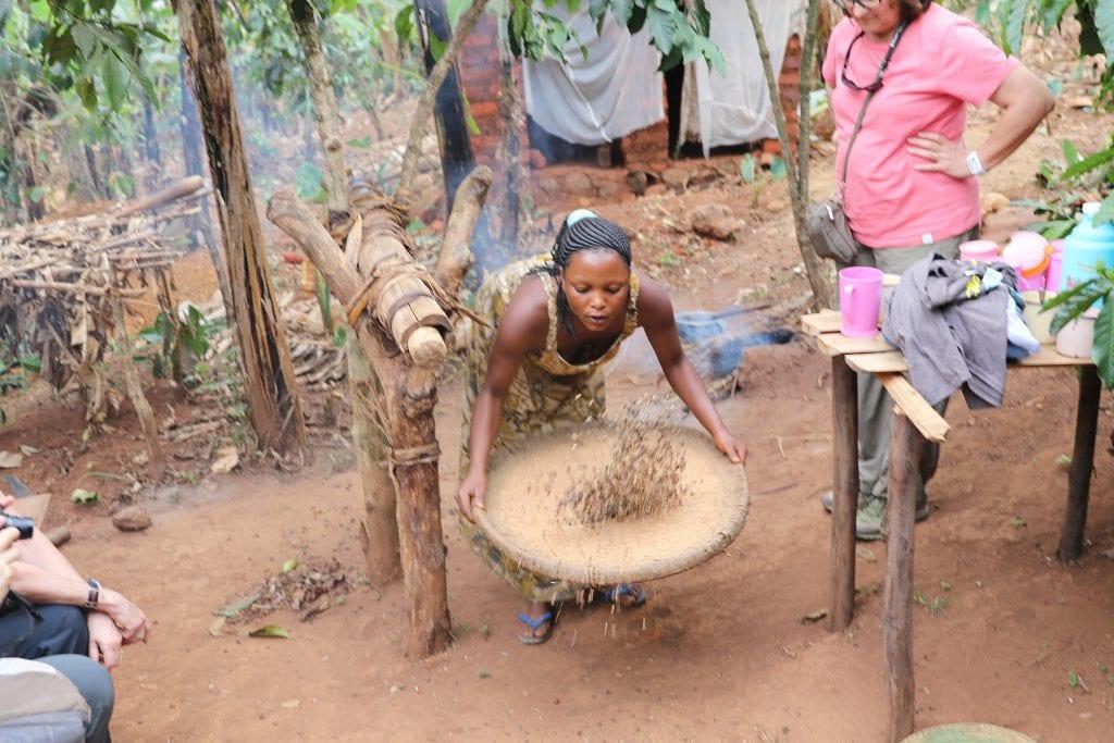 A Ugandan woman prepares coffee beans