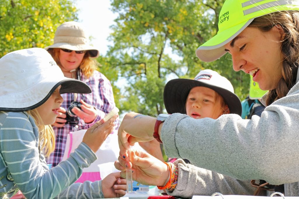 With the help of Wilderness Inquiry staff, children learn about water quality