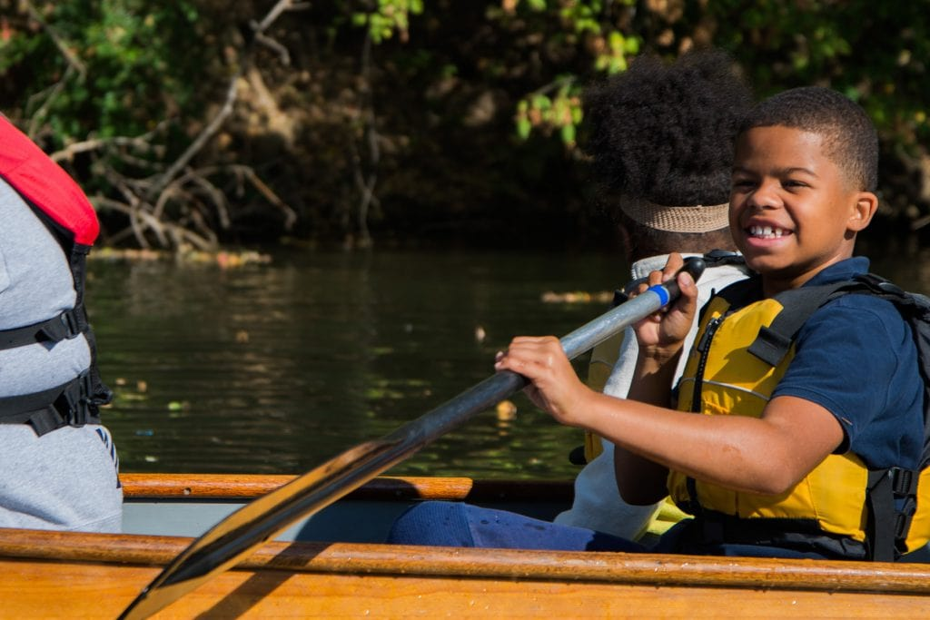 A young student enjoying the paddle.