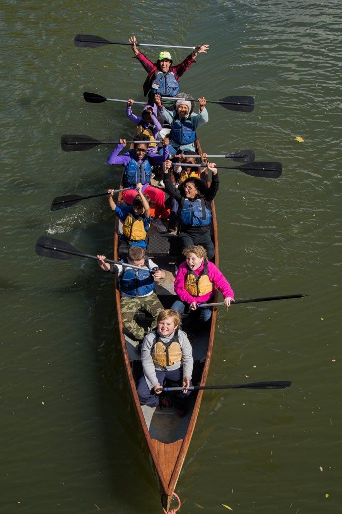 Students celebrate their canoe ride.