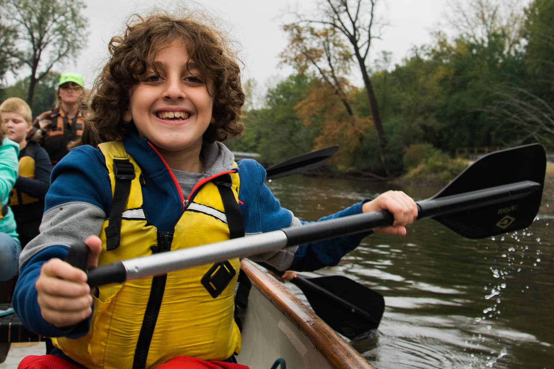 A student enjoys paddling on the Kankakee River.