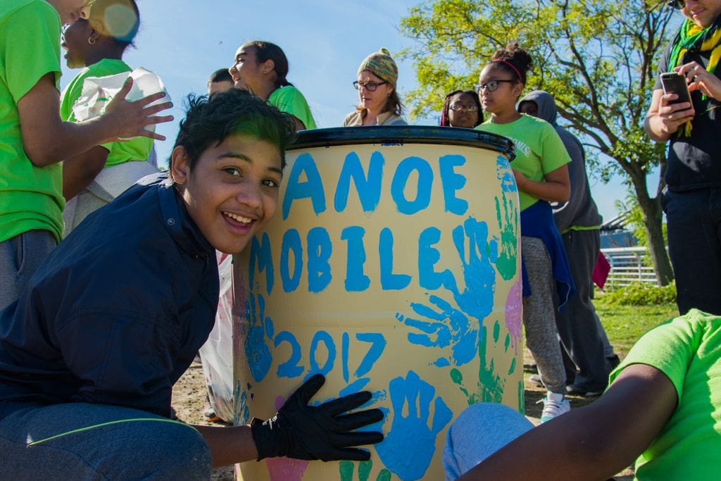 Students in Philadelphia decorate a rain barrel.