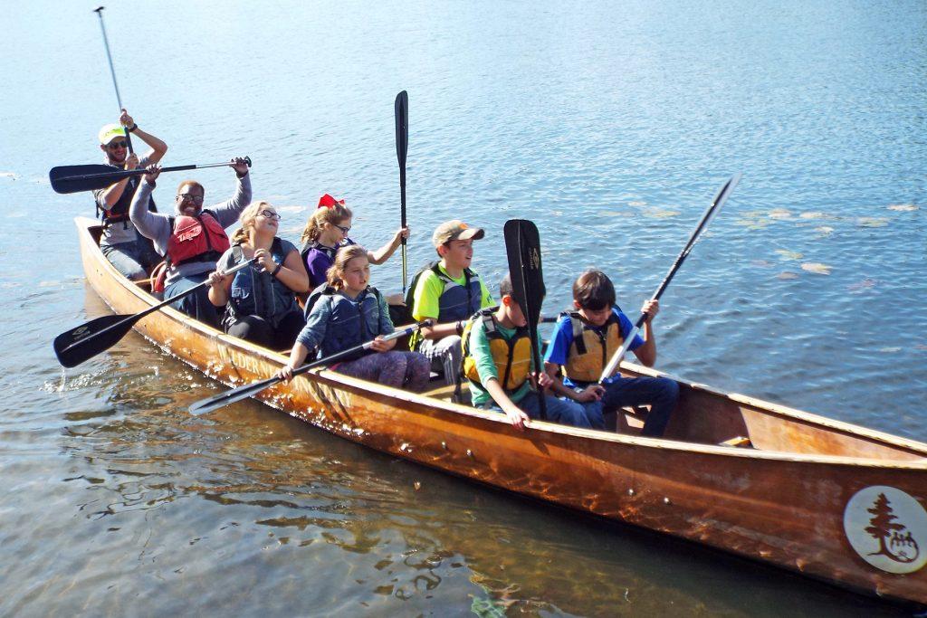 Gary Mayor Karen Freeman-Wilson paddles with students.