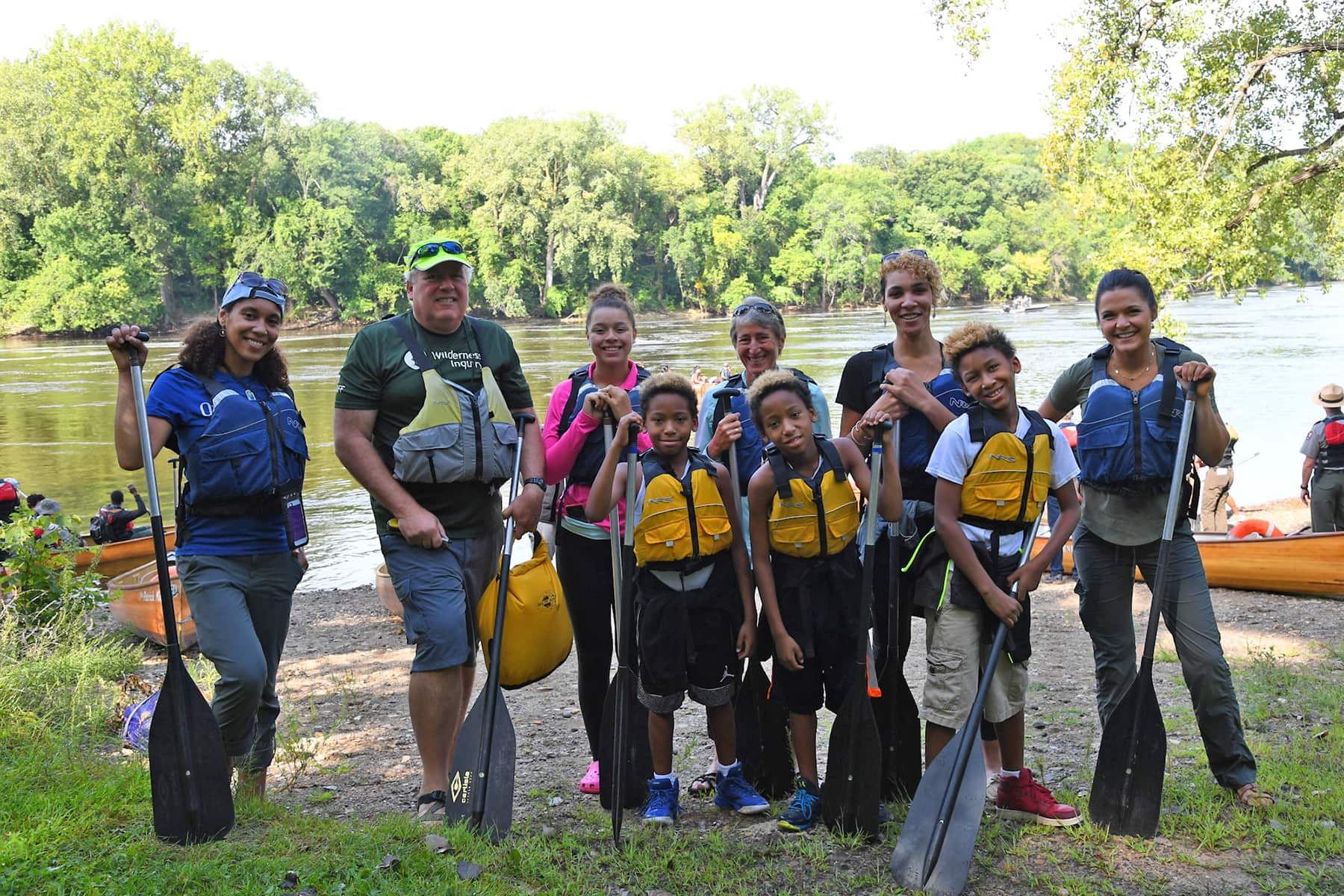 Founder Greg Lais on the banks of the Mississippi River with Sally Jewell and students