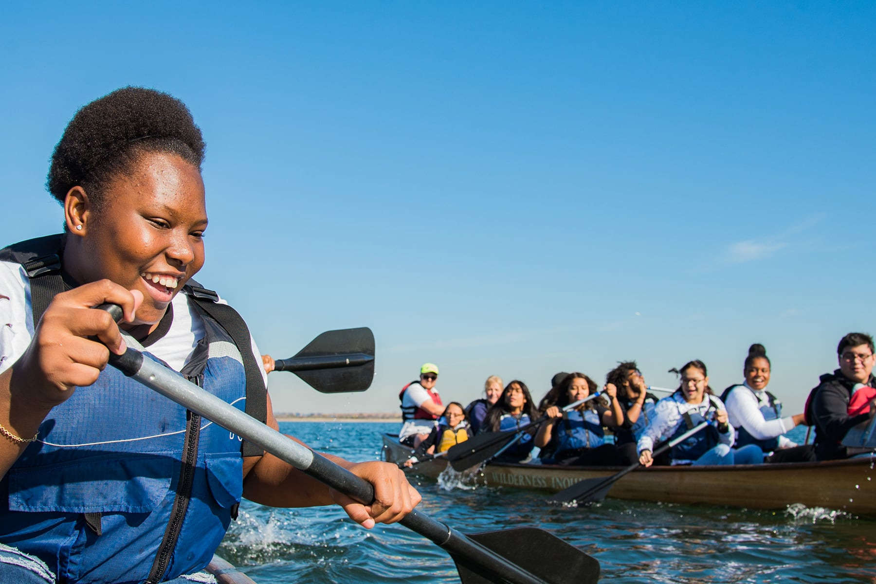 A student paddles in Jamaica Bay.