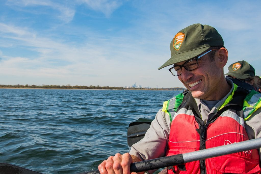 A National Park Service ranger paddles in Jamaica Bay.