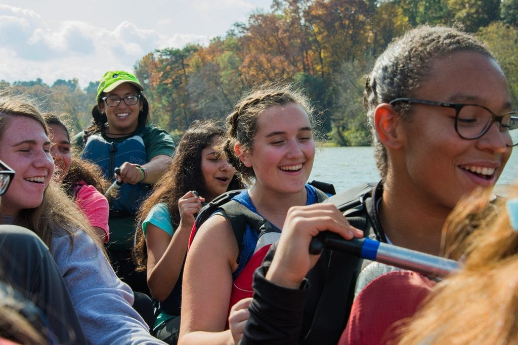 Students sing as they paddle the Chattahoochee River.