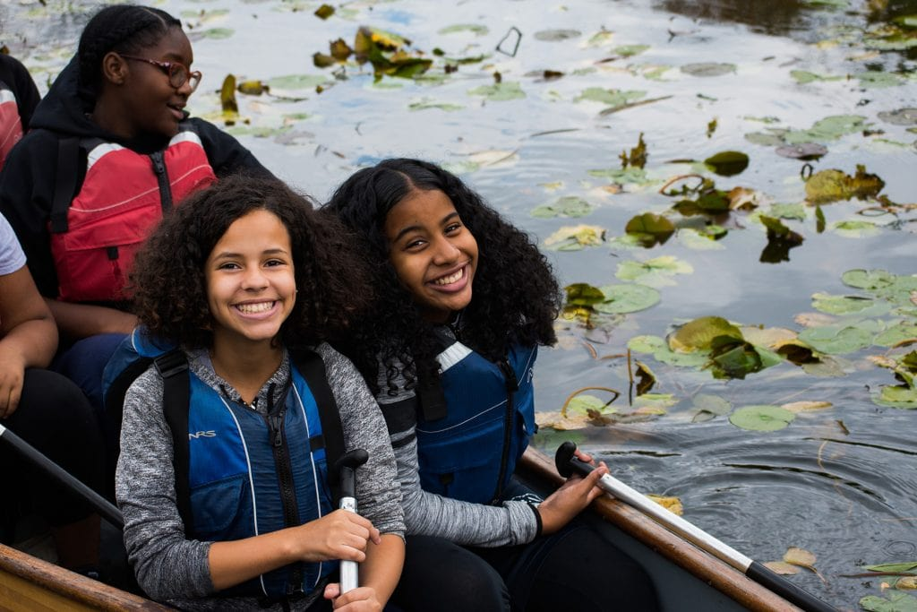 Two students smile during a paddle in Van Cortlandt Park.
