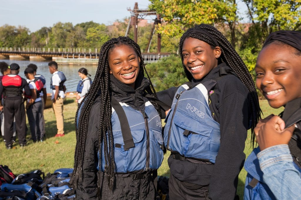 Two students are all smiles before the paddle.