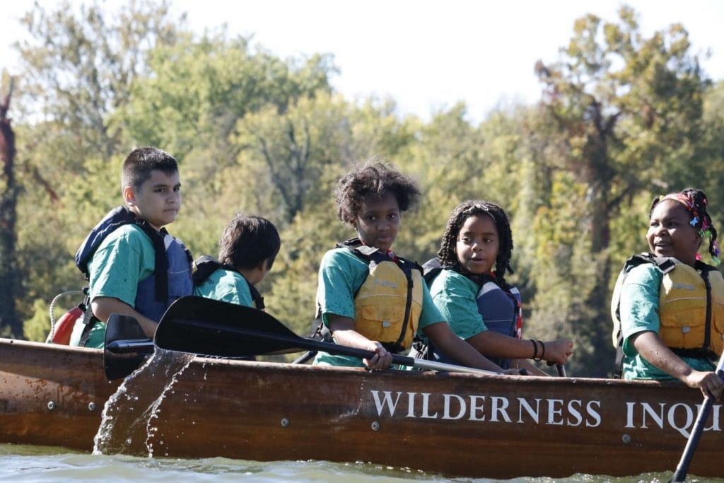 Fourth graders take a break from paddling