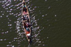Sparkling water kids paddling a Voyageur Canoe