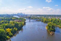 Aerial view of the Mississippi River with the Minneapolis skyline in the background