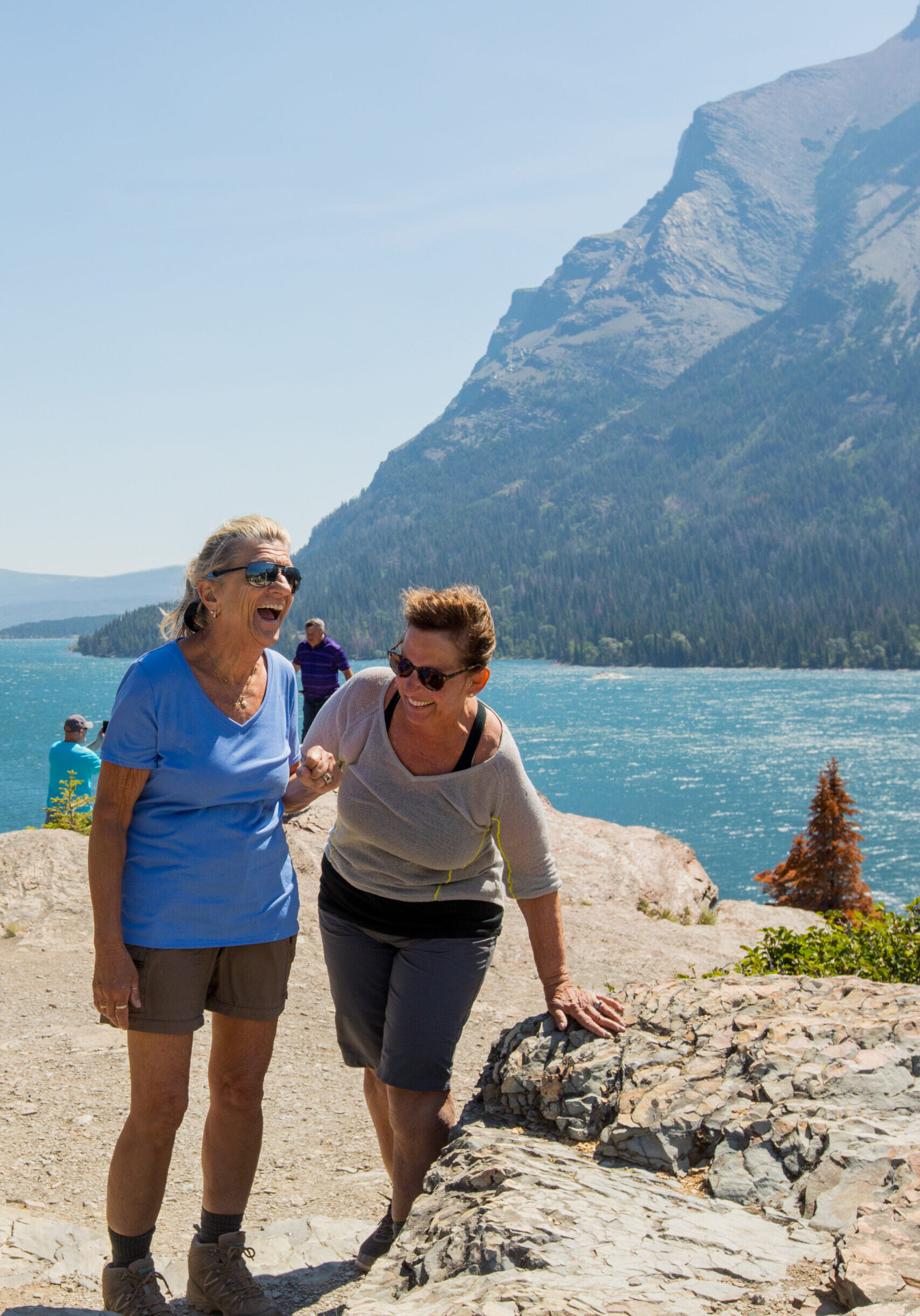 womens trip in glacier national park laughing